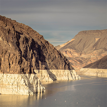 California drought - dry mountain range with a little water below