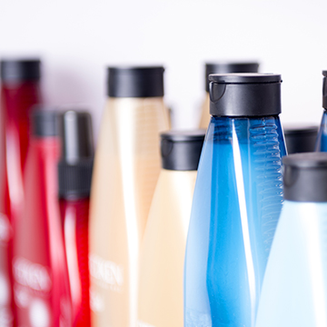 Blue, red and pink shampoo bottles