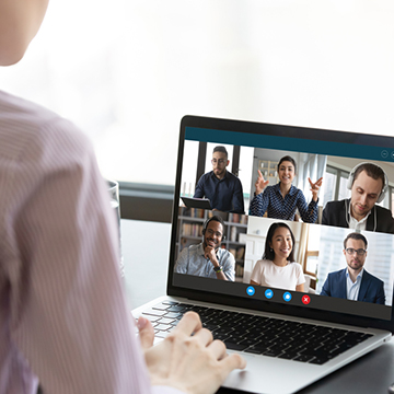woman viewing video conference or webinar on laptop